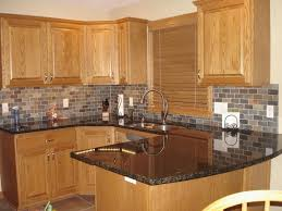 kitchen colors with light oak cabinets inspirational honey oak kitchen cabinets with black countertops
