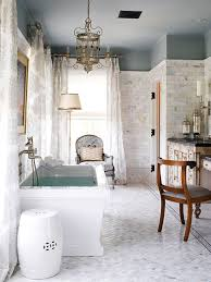 bathroom appealing tubular bathroom chandeliers in polished brass finish with laminate flooring also floor lamp