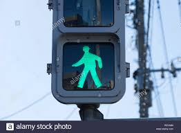 Walking Sign Light A Green Traffic Light Sign That Says People Can Walk Or