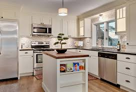 kitchen with white cabinets featuring mulligan glass doors oil brushed bronze cup pulls and open