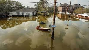 katrina then and now a man in new orleans 39 lower ninth ward rides a canoe in high
