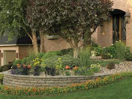 curved raised planting area made with chiselwall concrete block retaining walls