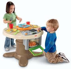 fisher price servin surprises kitchen table amazon co uk toys