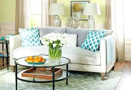 white living room walls muted blues greens gray and off white color scheme living room wall