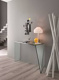 narrow hallway modern house design with gray wall interior color and rectangle clear glass console table on hardwood floor tiles plus white table lamp