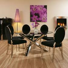 luxury round dining table and chairs for 6 with black glass top and modern interior design also using creative wall art