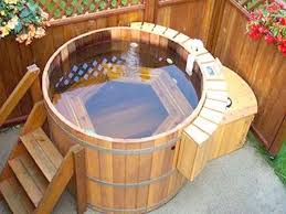 this tub is a gorgeous sight it s circular but has a hexagon bench it s truly unique there are also steps with a handrail to make it easy to get in and