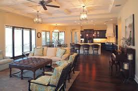 Tuscan open concept living room photo in Tampa with beige walls