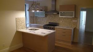 Soft Flooring For Kitchen Brown Wooden Kitchen Cabinet And Island With White Countertop On