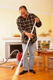 vacuuming and sweeping often go together when cleaning wood floors