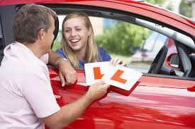learner driver with l plates in car car insurance