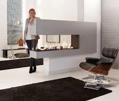 Разделительная стена с камином вместо 3д панелей ontemporary 3 sided fireplace gas closed