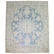 light blue antique persian rug for