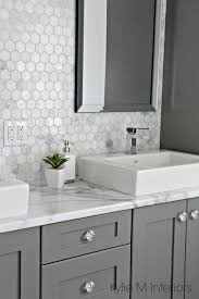 bathroom with fake marble countertop and real marble backsplash