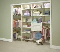 opened baby closet organizers and four hanging clothes areas and white wooden drawers and shelves also small white bench