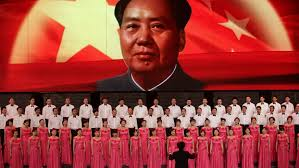 a petition calls for canceling tribute concerts to ldquo mass murderer participants sing in front of a screen showing s late chairman mao zedong during a revolutionary