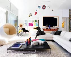 modern living room with white sofa unique black coffee table sliding glass door and ecletic mix of art image