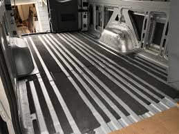 van rubber floor mass loaded vinyl 1 2 poly iso wood combo glued to the factory ply floor and finally the finish layer of carpet and coin vinyl