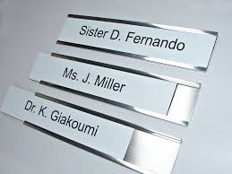 interchangeable metal nameplate holders