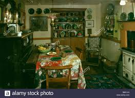 Old Fashioned Kitchen Piano And Table With Floral Cloth In Dark Old Fashioned Kitchen