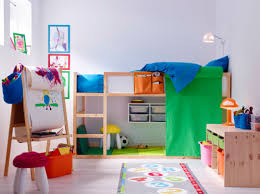 A colorful children's room with a loft bed in solid pine with space  underneath for drawing