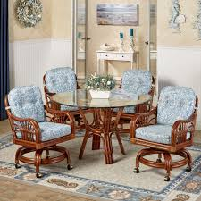 Tropical dining room furniture Elegant Leikela Round Dining Table With Caster Chairs Malibu Seaside Round Set Of Five Touch Of Class Leikela Malibu Seaside Tropical Dining Furniture Set