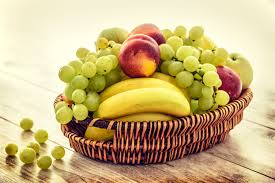 green and red apples in basket. green grapes, red apple and yellow banana fruit on basket preview apples in e