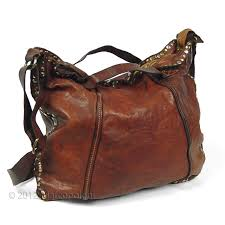 doria studded shoulder bag with handles in cognac