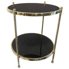 two tier brass and black glass side table for