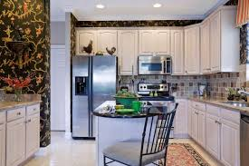 An Eclectic Kitchen With A Small Island And An Ornate Black Wallpaper That  Creates An Interesting Design Ideas
