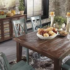 Mestler Dining Table Brown Pine and Server Buffet Ashley