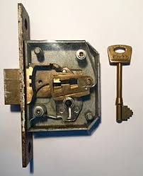 a 5 lever lock which is designed to be mortised into a door the faceplate has been removed to see the inner workings