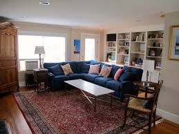 living room white color combinations brown gy area rug wooden pedestal round table made black chest