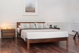 low solid wood bed frames for a rustic look it s easy to create a cosy contemporary bedroom by using a modern low solid wood bed with stylish bedding
