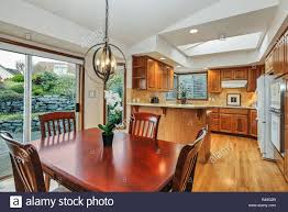 Kitchen Room Interior In American House With Cherry Wood Dining Room