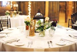 round table wedding centerpieces rustic wedding at the round barn photography wedding table decor ideas purple