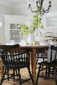 wood table with black chairs diffe style chairs house tour the wicker house find this pin and more on dining room