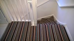 Some people say that you can't do a good job with a striped carpet on a  staircase with a bend. Well, dare I say, if you know what you are doing  when ...