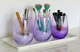 three purple mod podge gles are used for makeup storage and organizing