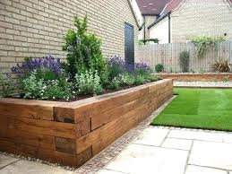 if handy with power tools you can take landscaping timbers and cut raised garden wood wooden