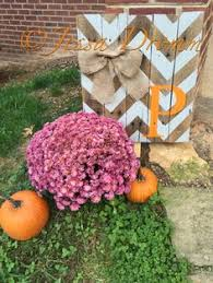 Chevron initial yard sign for fall, made out of pallet wood