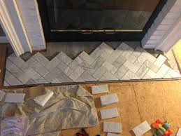 chic meets healthy fireplace hearth pt 1 herringbone marble tile hearth