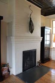 cavallo point white painted brick fireplace with either a slate or painted poured concrete hearth
