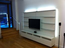 Long White Floating Media Cabinet Integrating With Glass Wall Shelves And  Lighting Around