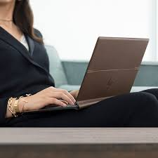 spectre folio leather top sitting on woman s lap
