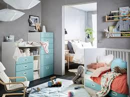 a blue grey red and white nursery with a white and light blue stuva