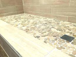 river rock flooring river rock floor tile rock tile showers pebble rock shower floor traditional troy