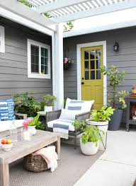 summer outdoor furniture. think relaxed outdoor vibe a mixture of patterns weathered gray furniture and lots lush greenery check out how my patio looked last year summer