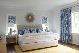 yellow and blue bedroom with light blue walls and windows covered in thom filicia prospect fabric in lake