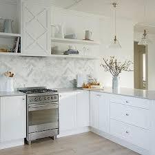 half tiled marble herringbone tile kitchen backsplash